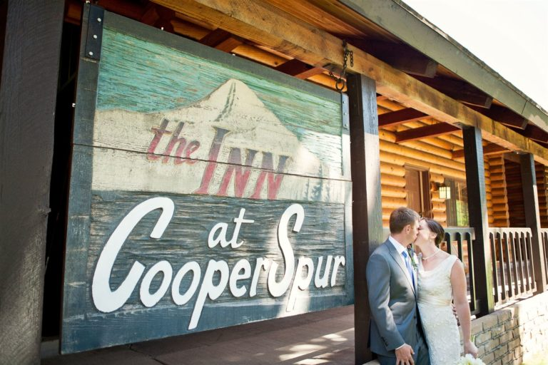 Wedding Couple Kissing Outside Main Lodge (with Rooms and Condos)- Lodging at Cooper Spur Mountain Resort